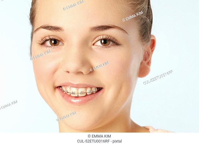 Close up of smiling girl in braces