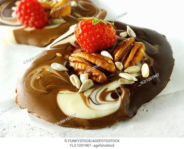 white and milk chocolate swirls with strawberries