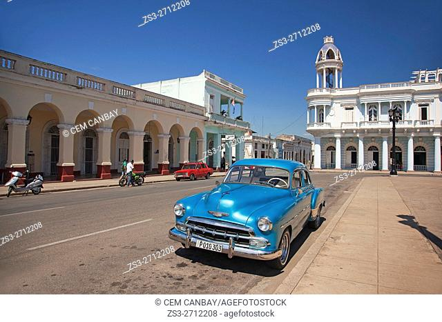Old American parked in front of the Ferrer Palace-Palacio Ferrer in Plaza de Armas near Jose Marti Park, Cienfuegos, Cuba, West Indies, Central America
