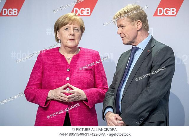 15 May 2018, Germany, Berlin: German Chancellor Angela Merkel (CDU) speaking with chairman Reiner Hoffmann during the national congress of the Confederation of...