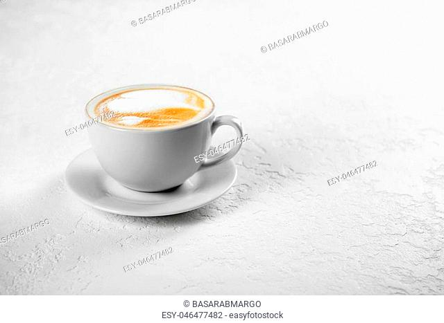 Cup of art latte on a cappuccino coffee on white background
