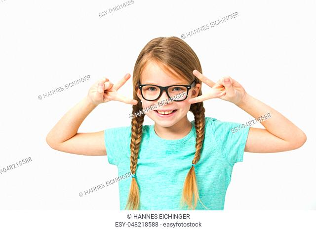 pretty girl with black glasses and plaits in front of white background in the studio