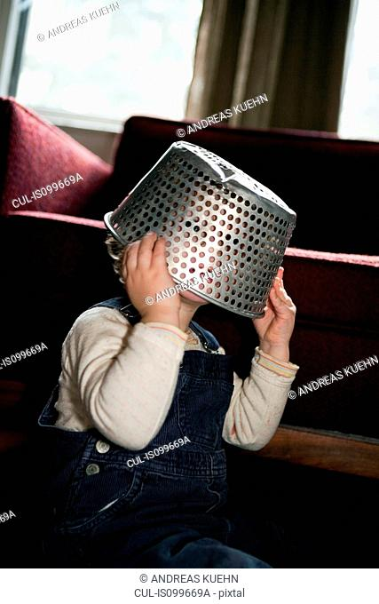 Boy with colander on head