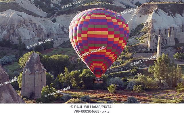 Hot Air Balloons over the volcanic rock formations of Love Cappadocia, Anatolia, Turkey