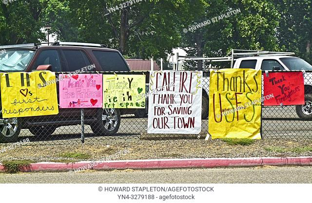 Signs on the perimeter of the Shasta County Fair Grounds in Anderson, California thanking firefighters and others working to contain the Carr Fire in Northern...