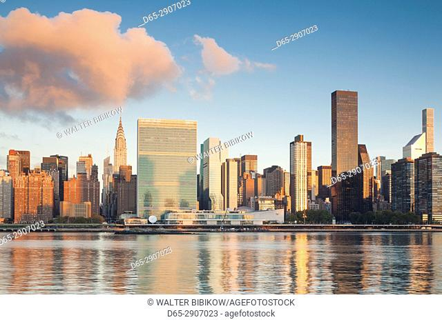 USA, New York, New York City, Long Island City, Mid town Manhattan skyline with UN building, dawn