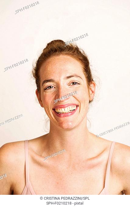 Portrait of happy young woman smiling