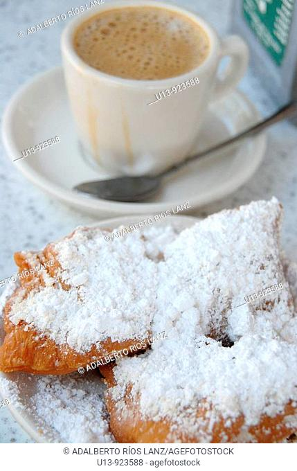 Typical breakfast with beignets and coffee at Cafe du Monde, French Quarter, New Orleans, Louisiana, USA