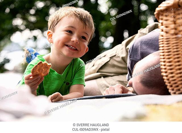 Boy enjoying picnic with father