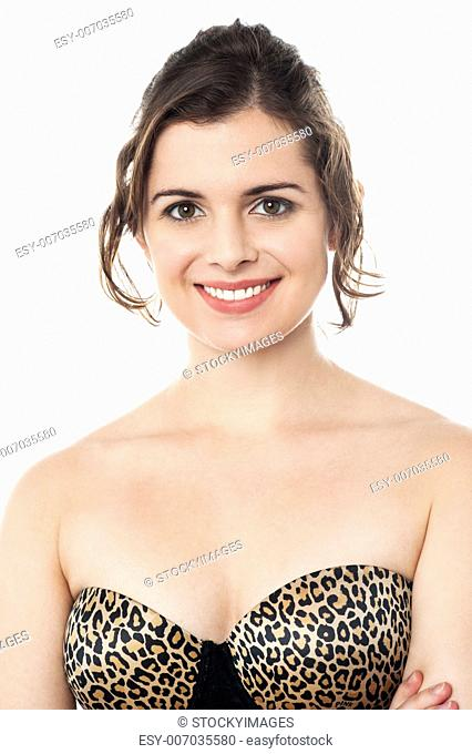 536aa68b61f Profile shot of a lingerie model standing against white background wearing  strapless brassiere