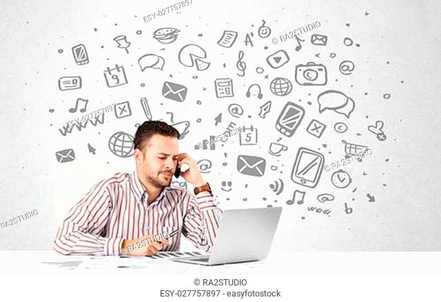 Good-looking young businessman with all kind of hand-drawn media icons in background