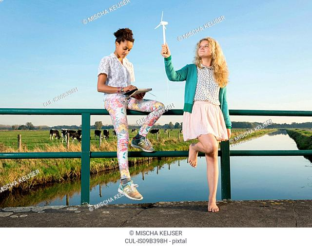 Children using miniature wind turbine to power digital tablet, Breda, Netherlands