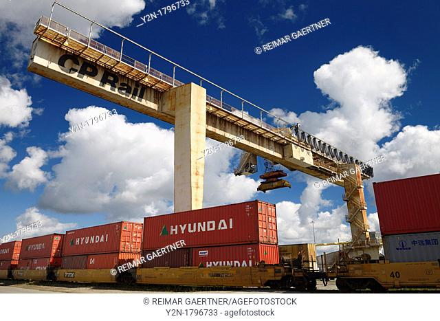 Fixed concrete bridge container crane at a railway transport depot for transfer to trucks