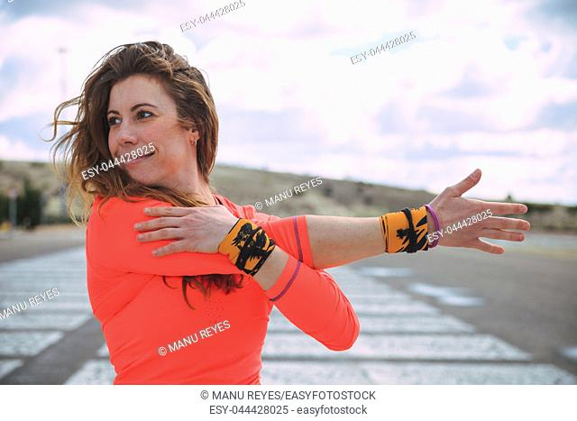young woman stretching on the outdoors before to run