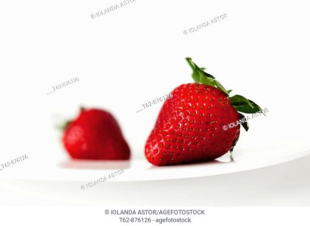 Two strawberries on a plate  Still Life