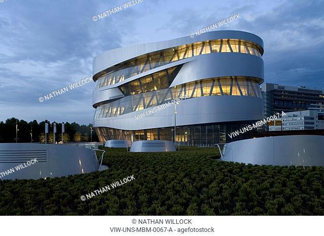 MERCEDES MUSEUM, MERCEDESSTRASSSER 100, STUTTGART, GERMANY, UN STUDIO BEN VAN BERKEL AND CAROLINE BOS, EXTERIOR, TWILIGHT OF THE WEST ELEVATION WITH LANDSCAPING