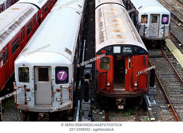 New York, Old tracks and wagons subway in Flushing Meadow. The 7 Flushing Local and <7> Flushing Express are two rapid transit services in the A Division of the...