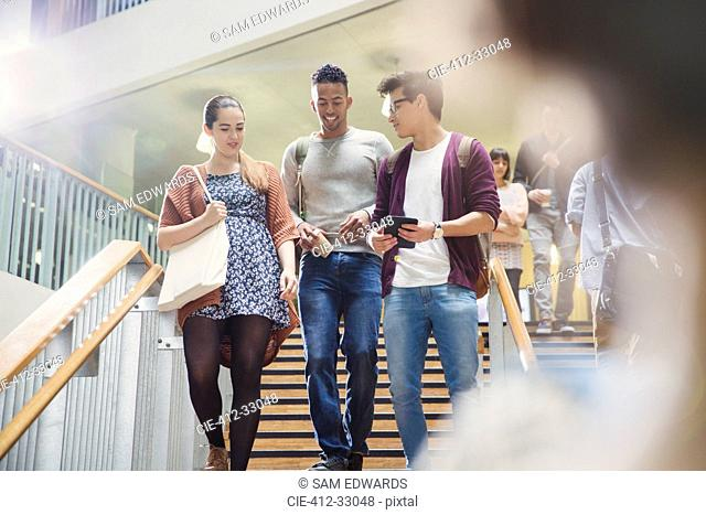 College students talking and descending stairway
