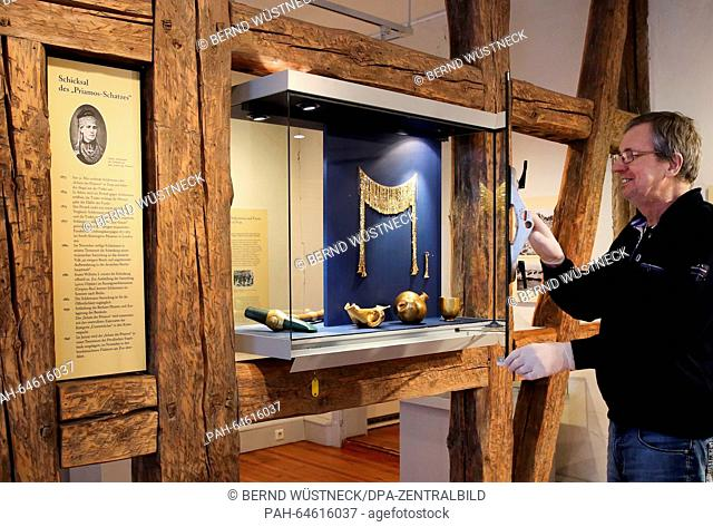 Director Reinhard Witte shows replicas of the gold diadem and other finds from the presumed site of Troy by Heinrich Schliemann