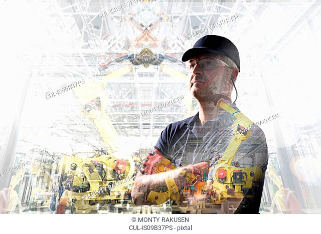Conceptual image of factory worker in car factory