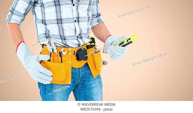 Mid-section of handy man with tool belt
