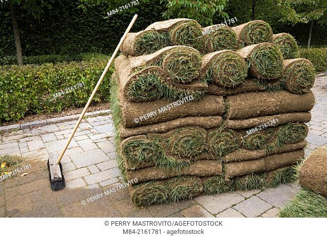 Stacked rolls of sod and broom, Quebec, Canada