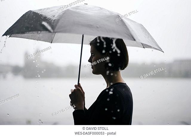 Woman with umbrella on a rainy day