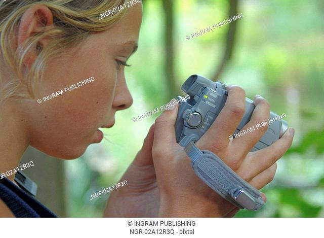 Close-up of a girl using a home video camera