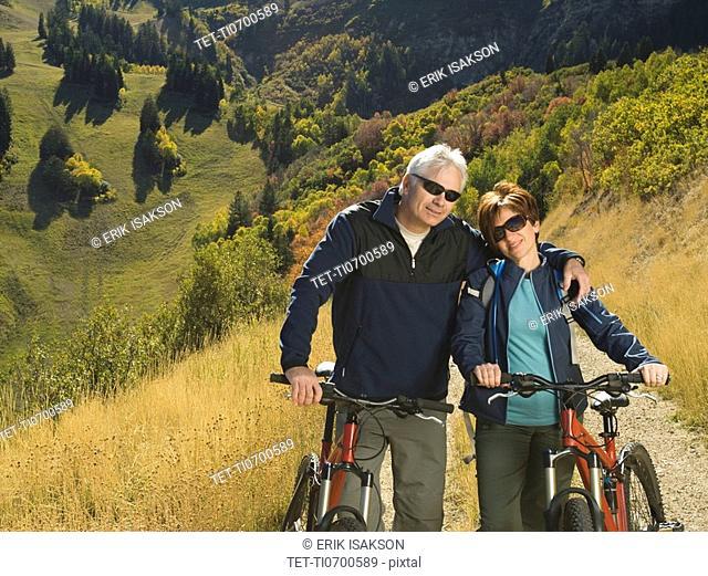 Senior couple with mountain bikes, Utah, United States