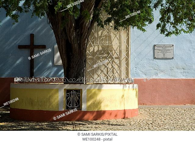 Cross adorning a wall in a public square, Trinidad, Sancti Spiritus, Cuba