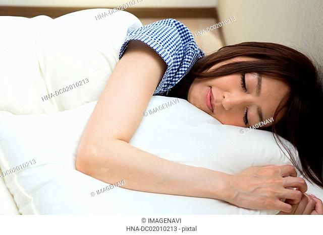 A woman sleeping in the bed