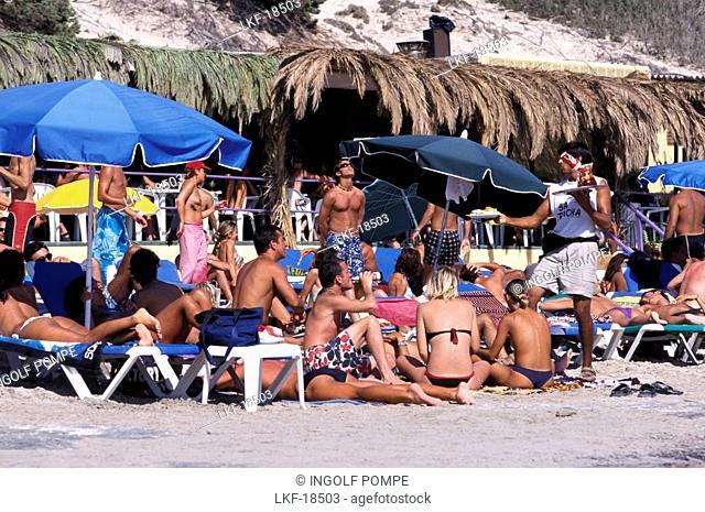 Group of young people on the beach, Sa Trincha, Platja de ses Salines, Ibiza, Spain