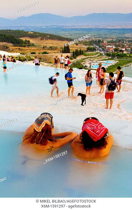 Travertine terrace formations and tourists  Pamukkale  Denizli province  Anatolia  Turkey