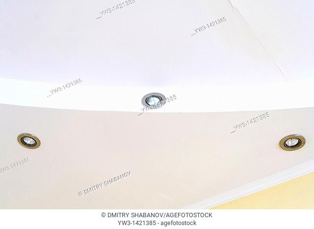 Ceiling with lamps on light grey tones