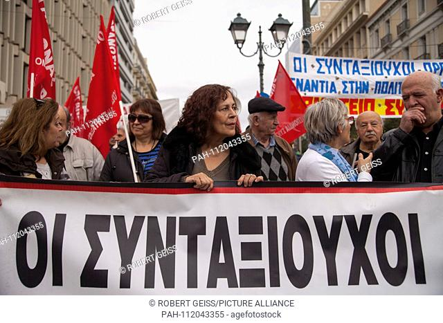 """Greek pensioners during protest against planned cut in pension payments beginning 2019. Banner """"""""The Pensioners"""""""". 20.11.2018 