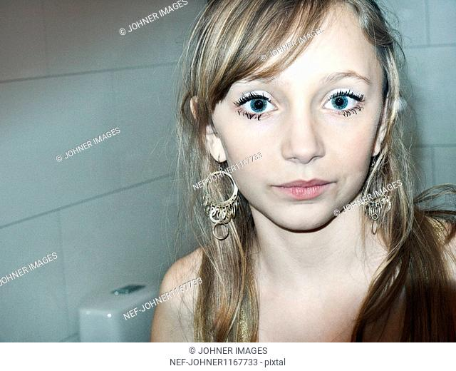 Portrait of young girl with eye make-up