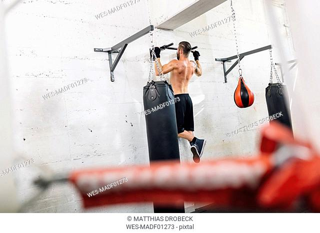 Athlete exercising in boxing club