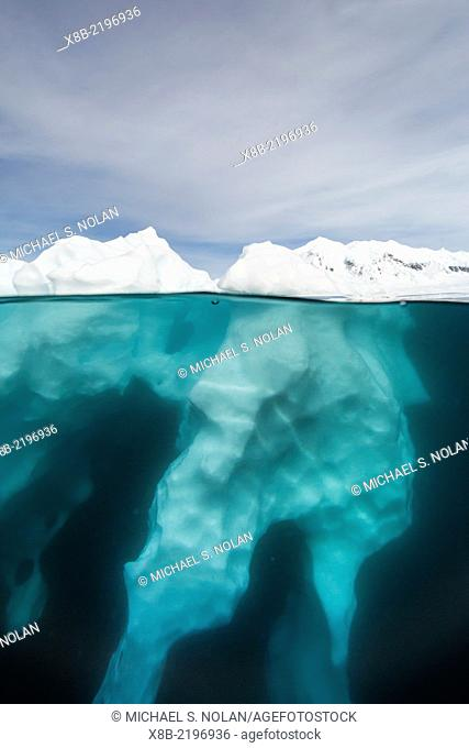 Above and below view of glacial ice near Wiencke Island, Neumayer Channel, Antarctica