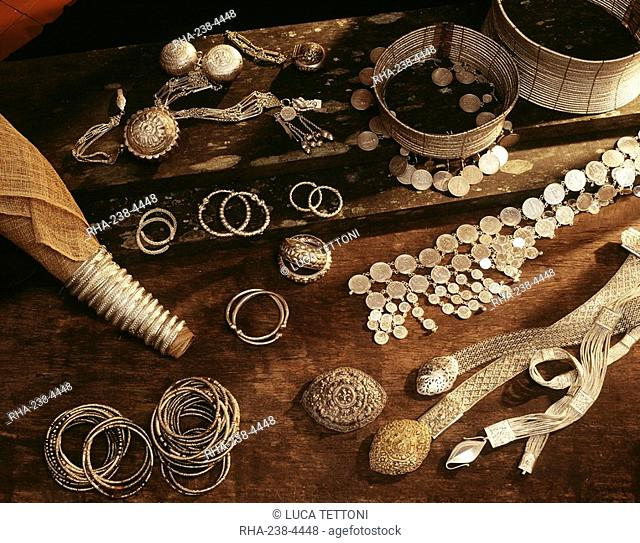 Silver coiled Rawai corsets and bracelets of native Maloh craftmanship as well as knitted silver belts, coin belts, and powder boxes for Iban in Sarawak, Borneo