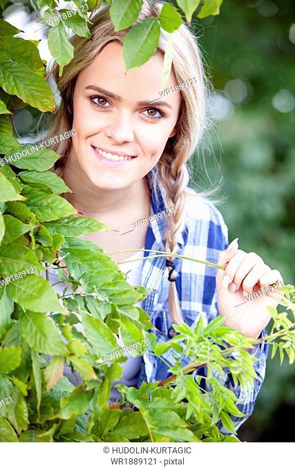Grape harvest, portrait of young woman, Slavonia, Croatia