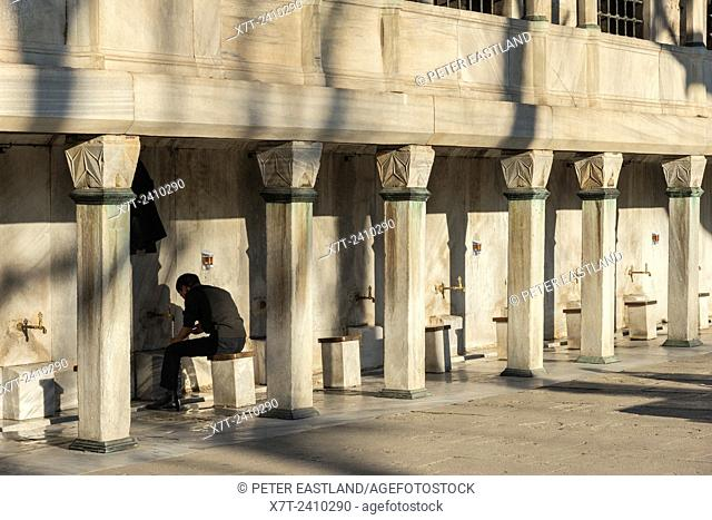 Man Washing before entering for prayer at the Sultan Ahmet or Blue Mosque, Sultanahmet, Istanbul, Turkey