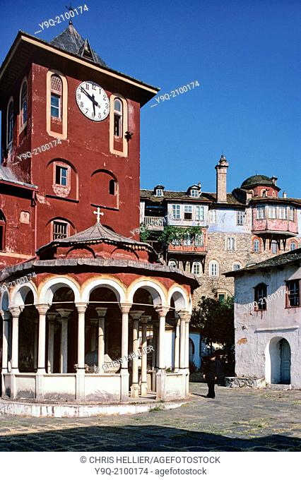 Clock Tower Fountain & Greek Monk in Courtyard of Vatopedi Monastery Mount Athos Greece