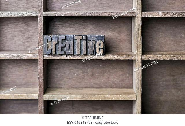 old wooden printers type forming the word Creative