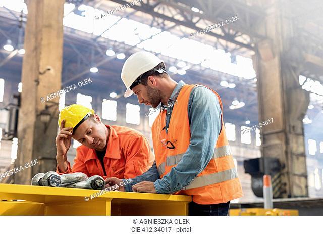 Steel workers meeting in factory