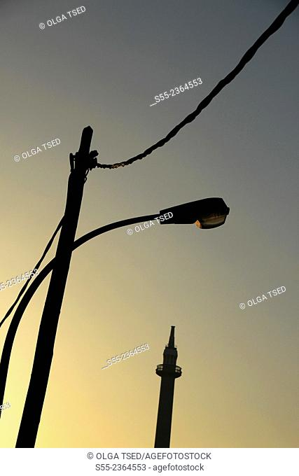 Street light and the high chimney of an old cement factory. Sant Just Desvern, Barcelona province, Catalonia, Spain