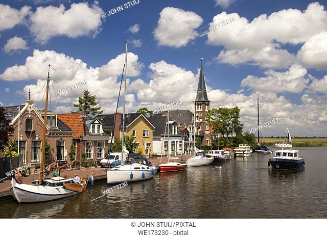 View at the Frisian village Woudsend which is a very busy water sports village in summer