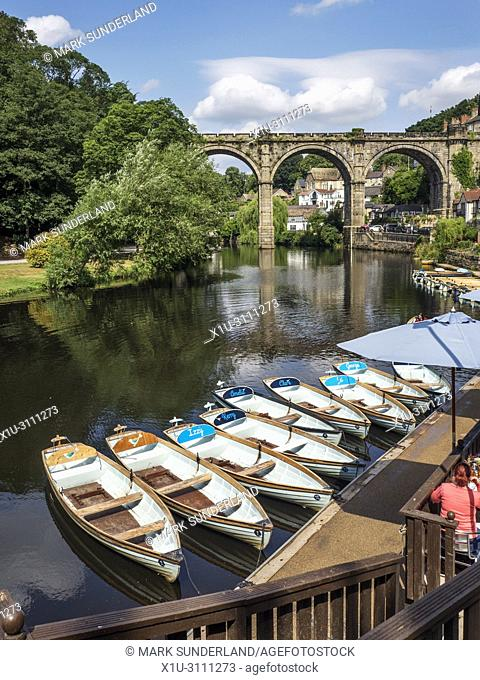 Rowing boats on the River Nidd below the railway viaduct at Knaresborough Yorkshire England