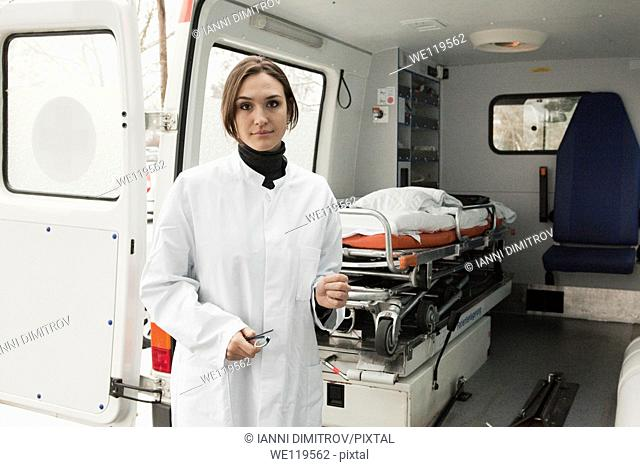 Female doctor by ambulance