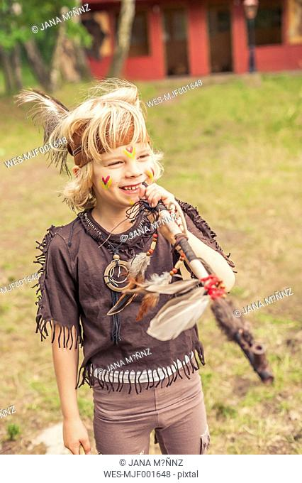 Germany, Saxony, Indians and cowboy party, Blond boy with bow and arrow