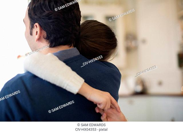Affectionate father and daughter hugging